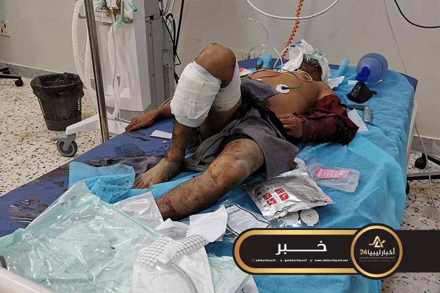 صورة قتلى وجرحى بينهم أجانب جراء قصف مصنع بوادي الربيع جنوب طرابلس