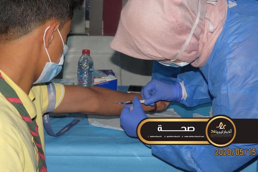 صورة العائدين من مصر..الكشف على 30 مواطن عقب دخولهم للحجر الصحي في البيضاء