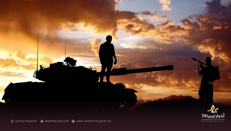 """صورة لرغبته في مواجهة الإرهاب..قصة الشاب """"مروان"""" الذي صعد على ظهر دبابة للدواعش يحمل """"حجرًا"""""""